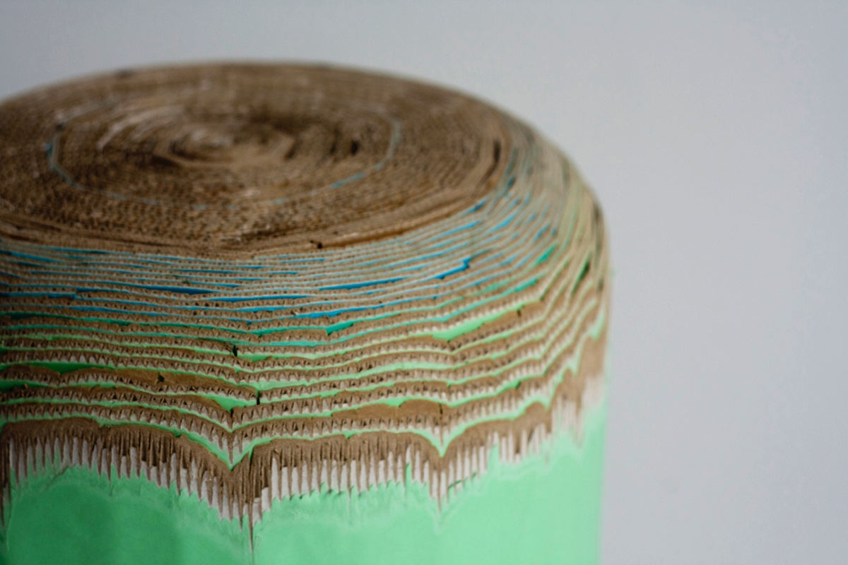 The Cardboard Stool is created by rolling corrugated cardboard into elongated